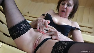 Guileful mature Dana in ebony lingerie drops on her knees to suck a dick