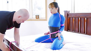 Bed bounce in blue catsuit
