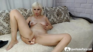Lusty blonde shoves a toy purchase their way slit